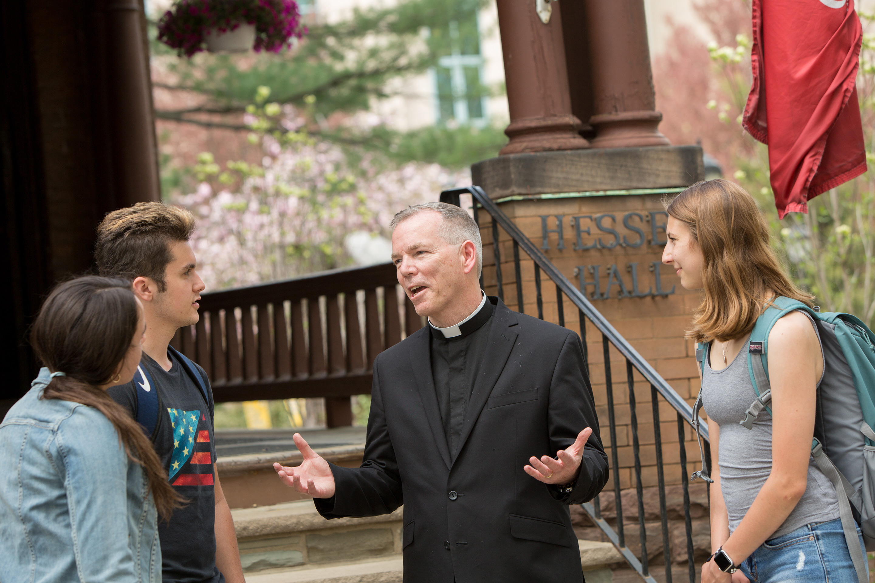 King's College President, Rev. Thomas Looney, CSC, PhD with students